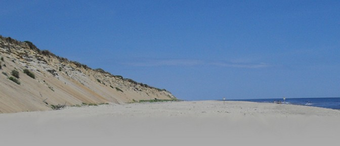 huge sand dunes tower over marconi beach in wellfleet, part of the cape cod national seashore