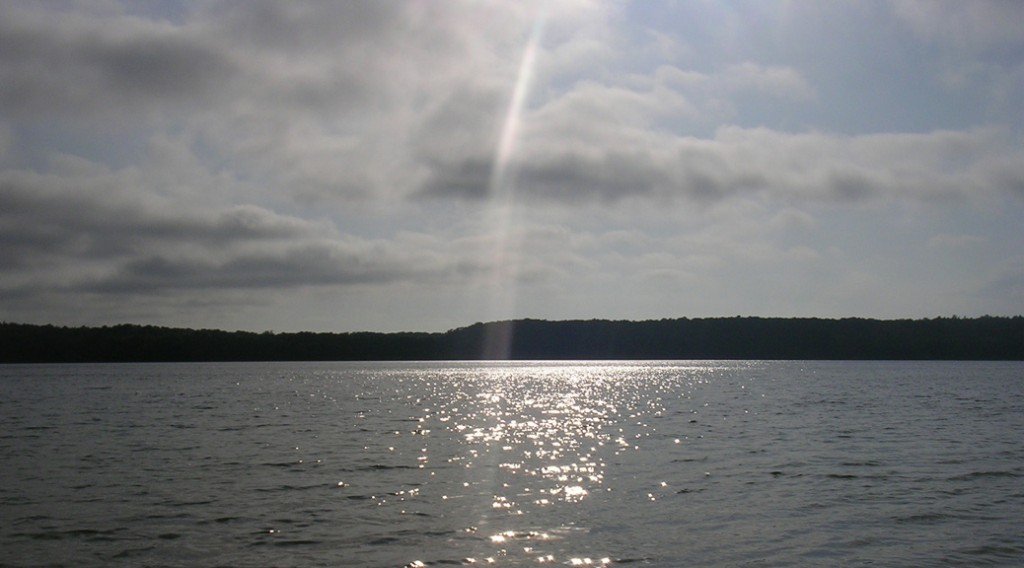 Light reflects of Big Cliff Pond in Brewster
