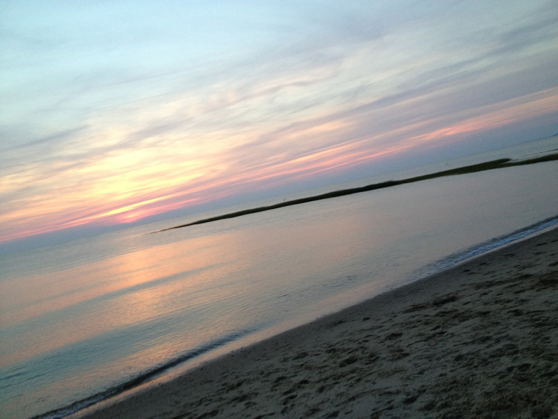 sunset as seen from an oversand beach trail on cape cod