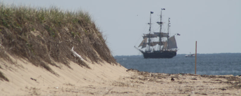 a tall ship passes the orv trails on the north side of race point beach in 2015