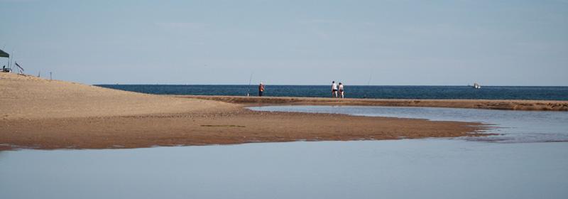 Walking on a sandbar on cape cod