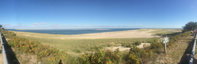 Panoramic photo showing Chatham Light beach from the parking lot.