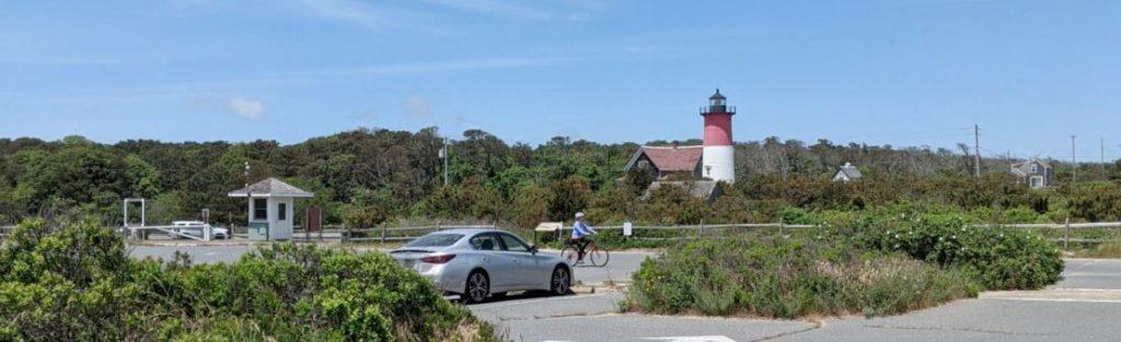 Nauset Lighthouse overlooks the parking area at Nauset Light Beach.